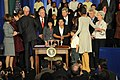 Secretary Sebelius congratulates the First Lady at the signing of the Healthy, Hunger-Free Kids Act of 2010.jpg