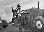 Sergeant Bohumil Furst of No. 310 (Czechoslovak) Squadron is greeted by the squadron mascot on returning to Duxford after a sortie in his Hawker Hurricane Mk I, 7 September 1940. CH1296.jpg