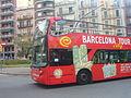 Sightseeing bus in plaça Joanic.JPG