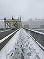 Snow footprints on Smithfield Bridge (16195331180).jpg