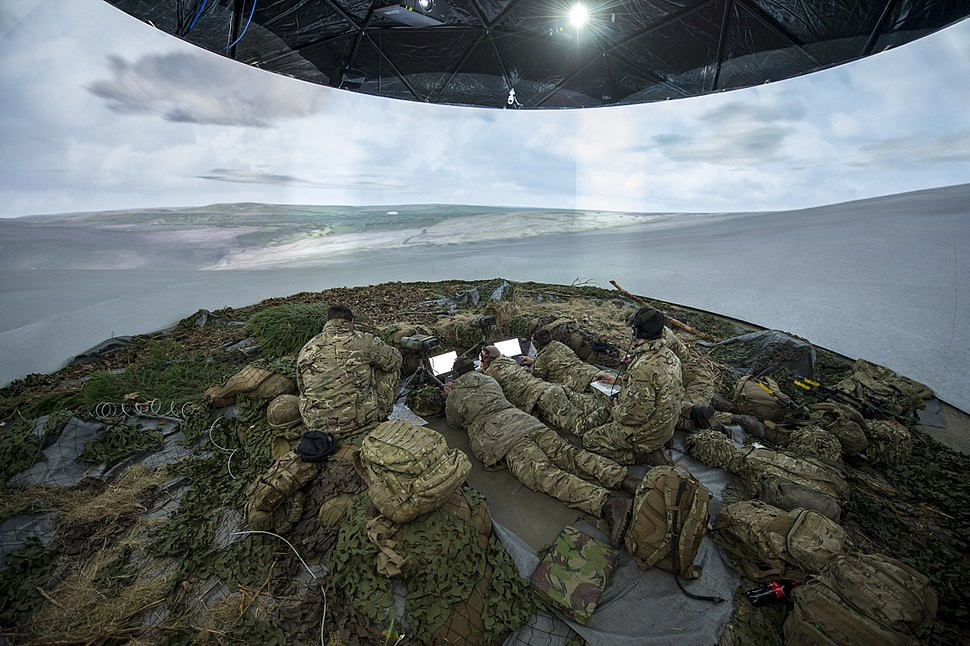 Soldiers from the Royal Artillery inside the FST Simulation tent, which uses 360 degree technology to assist in training during Exercise Steel Sabre. MOD 45158564