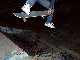 Benihana (skateboarding) - A skateboarder performs a benihana.