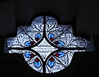 Stained glass rosette in the Saint Antony church -St. Ulrich.jpg