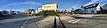 Stord town hall (rådhus) by Vikabrekko (fylkesveg 544) in Leirvik, Stord Island, Norway. Esso petrol station, Sunn Bok, bus station, Industriarbeidarmonumentet (Trygve Barstad), etc. Compressed, distorted panorama 20.jpg