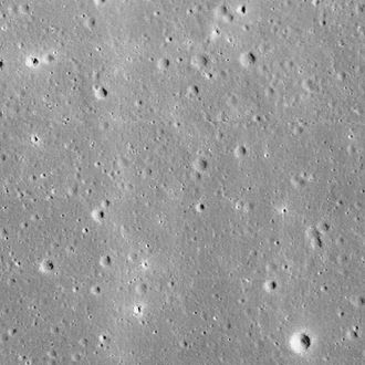 Surveyor 1 - Lunar surface centered on the landing site, photographed by Lunar Orbiter 1 in 1966.  View is 7 km wide.