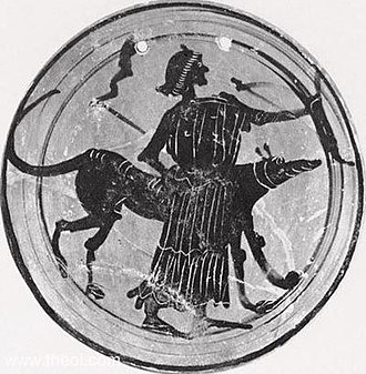 Hecate - A goddess, probably Hekate or else Artemis, is depicted with a bow, dog and twin torches.