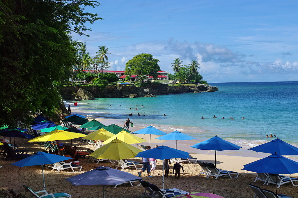 Colourful umbrellas cover a beautiful Caribbean beach in Tobago