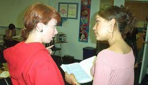 Teacher talking to student at LSI