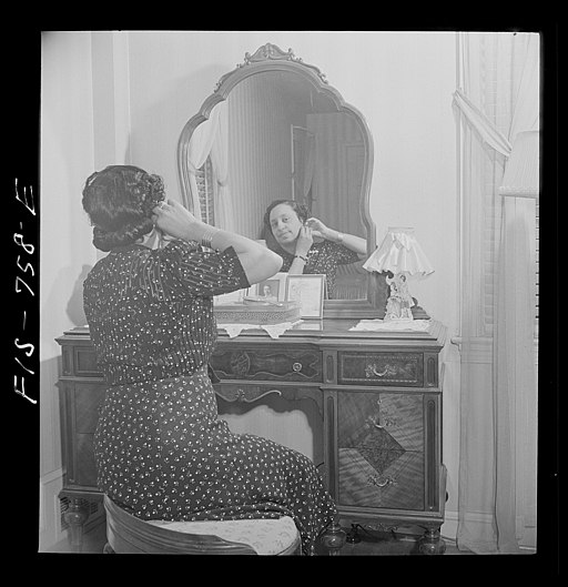 Teacher in a Negro grammar school in her bedroom at home. 8d20236v
