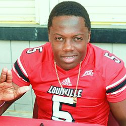 Teddy Bridgewater poses for fan day.jpg