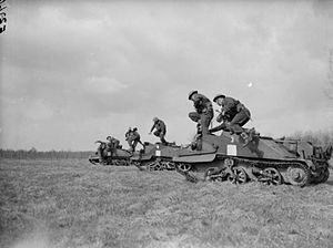 2nd Infantry Brigade (United Kingdom) - Troops from the 1st Battalion, Loyal Regiment (North Lancashire) leap from their Bren gun carriers while training at Bourghelles, 21 March 1940.