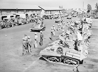 7th Armoured Division (United Kingdom) - Light Tank Mk VIs and lorries of the 8th King's Royal Irish Hussars assembled ready to move off for an exercise in the desert, 5 June 1940.