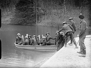 56th (London) Infantry Division - Men of the 1st Battalion, London Irish Rifles training in boat handling on a lake in Pippington Park, East Grinstead, April 1940.