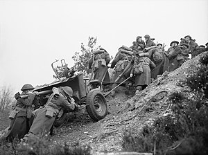 3rd Division (United Kingdom) - Gunners of the 20th Anti-Tank Regiment, 3rd Infantry Division, haul a 2-pdr anti-tank gun up a steep slope during training at Verwood in Dorset, 22 March 1941.
