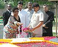 The Deputy President of the Republic of South Africa, Mrs. Phumzile Miambo-Ngcuka paying floral tributes at the Samadhi of Mahatma Gandhi, at Rajghat in Delhi on September 11, 2006.jpg