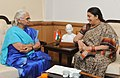 The Governor of Goa, Smt. Mridula Sinha calling on the Union Minister for Human Resource Development, Smt. Smriti Irani, in New Delhi on March 13, 2015.jpg