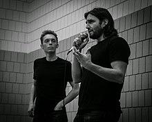 Joshua and Ryan speaking in 2014