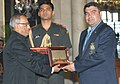 The President, Shri Pranab Mukherjee felicitates Shri Gagan Narang, the London Olympic Bronze Medal winner in Shooting, at a function, in New Delhi on August 18, 2012.jpg