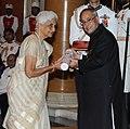 The President, Shri Pranab Mukherjee presenting the Padma Shri Award to Smt. Durga Jain, at an Investiture Ceremony-II, at Rashtrapati Bhavan, in New Delhi on April 26, 2014.jpg