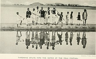 Robert Vane Russell - Kunbi people throwing stilts into the water at the Pola festival as depicted in Tribes and Castes of the Central Provinces of India