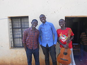 Youth in Rwanda - Three Rwandan youth outside of their home.