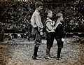 Three boys with Down's syndrome, standing in a line. Photogr Wellcome V0030054.jpg