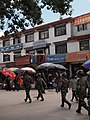 "Tibet- photo of Lhasa Kitchen restaurant--- Many soldiers held gun and walked in the main street during the celebration of ""Tibet liberation 60 anniversary "".jpg"