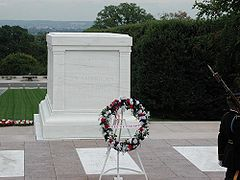 The World War I unknown is below the marble sarcophagus. Other unknowns are beneath the white slabs on the ground (World War II, left; Korean War, right). A Vietnam War unknown was under the middle slab until 1998, when he was identified.