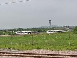 Trams passing near Ingliston (geograph 3505896).jpg