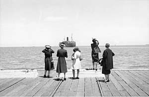 Military history of Australia during World War II - Women friends and family on the wharf waving farewell to the departing troop ship RMS Strathallan carrying the Advance Party of the 6th Division to service overseas. They include George Alan Vasey's wife Jessie Vasey (second from the left). The photograph is especially poignant because Vasey did not survive the war.