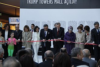 Recep Tayyip Erdogan, then the prime minister of Turkey, attended the opening of Trump Towers Istanbul AVM in 2012. Trump AVM opening ceremony.jpg
