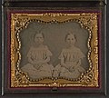 Two unidentified young girls, probably sisters, wearing matching dresses LOC 5228586261.jpg