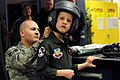 U.S. Air Force Tech. Sgt. Chris Shapiro, left, the 34th Bomb Squadron (BS) aircrew flight equipment assistant noncommissioned officer in charge, assists Aric Lassegard, 8, a 34th BS honorary aircrew member, with 110113-F-VK137-139.jpg