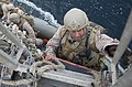 U.S. Marine Corps Staff Sgt. Mario Ormeno, assigned to the 13th Marine Expeditionary Unit embarked aboard the amphibious assault ship USS Boxer (LHD 4), climbs aboard the guided missile destroyer USS Mason (DDG 140112-N-PW661-033.jpg