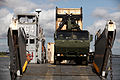 U.S. Marines from Combat Logistics Battalion 8, Transportation Support Company, work together with Navy personnel from Beach Master Unit 2 off-loading ISO containers off a Landing Craft Utility during 120615-M-KS710-039.jpg