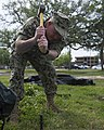 U.S. Navy Diver 1st Class Brett Harkey, with Mobile Diving and Salvage Unit 2, hammers a stake to stabilize a shelter system to serve as the unit's headquarters for diving operations during Ardent Sentry 2013 130513-N-IL267-028.jpg