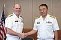 U.S. Navy Vice Adm. Matthew L. Nathan, left, U.S. Navy surgeon general and chief of the Bureau of Medicine and Surgery, and Japanese navy Rear Adm. Shigeki Yanagida, surgeon general and director of medicine with 130723-N-YA302-050.jpg