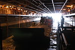 U.S. Sailors, assigned to the amphibious assault ship USS Bataan (LHD 5), secure lines while navigating an improved navy lighterage system into the ship's well deck during the 2008 exercise Sea-Based Dragon 080922-N-IF140-101.jpg