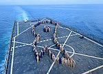 U.S. Sailors and Marines form a ribbon in observance of Sexual Assault Awareness Month aboard the amphibious dock landing ship USS Carter Hall (LSD 50) March 27, 2013, in the Mediterranean Sea 130327-N-XZ031-049.jpg