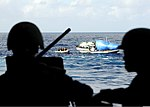 U.S. Sailors and Marines with the visit, board, search and seizure team, currently assigned to the guided missile cruiser USS San Jacinto (CG 56), board a suspicious dhow, from a rigid hull inflatable boat 100524-N-EF447-060.jpg