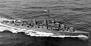 a small warship, two turrets forward, two smoke stacks, one turret aft