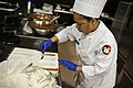 US Army Reserve Culinary Arts Team serves three-course meal to guest diners 160310-A-XN107-044.jpg