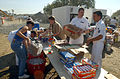 US Navy 010912-N-3235P-005 Military members keep food and beverages stocked.jpg