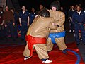 US Navy 030111-N-3505W-502 Sailors begin to rumble at the start of a Sumo Wrestling match, during Sports Night in the ship's hangar bay.jpg
