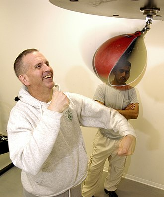 Boxing training - Lt. Cmdr. Philip Creider (US Navy), demonstrates the use of a Speed bag, a tool prominently used in training for boxing.