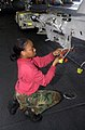 US Navy 030329-N-0413R-002 Aviation Ordnanceman 3rd Class April Bryson from Toledo, Ohio, configures the multiple ejector racks (MER) for a weapon's carriage in the hangar bay aboard the aircraft carrier USS Nimitz (CVN 68).jpg