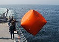 US Navy 030611-N-4374S-004 Sailors launch a killer tomato prior to executing a small arms training exercise aboard the Aegis-class cruiser USS Vella Gulf (CG 72) during the annual maritime exercise Baltic Operations 2003 (BALTO.jpg