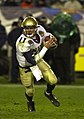 US Navy 031206-N-9693M-504 Navy quarterback Craig Candeto looks for a receiver downfield during the 104th Army Navy Game.jpg