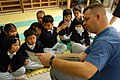 US Navy 040308-N-3614M-001 Master Chief Information Systems Technician Don Acker, of Augusta, Kan., reads to children at a daycare in Hong Kong.jpg