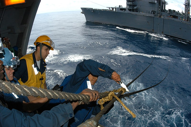 File:US Navy 040619-N-8704K-001 Boatswain Mate 3rd Class Joanna Saldana cuts the rope off a span wire aboard the aircraft carrier USS John F. Kennedy (CV 67) during an underway replenishment.jpg